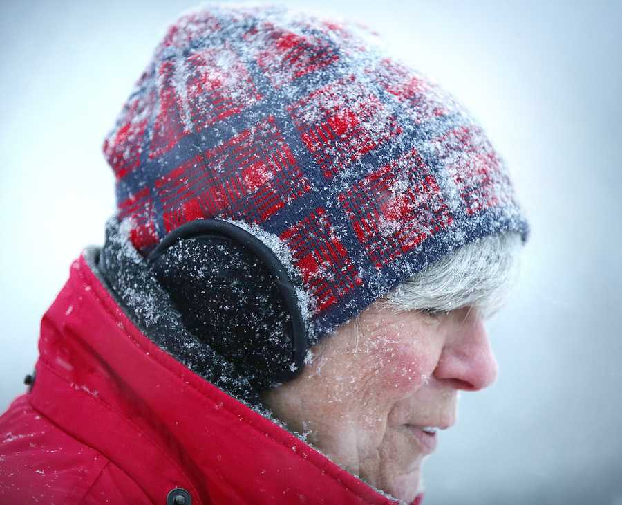 Mary Kelly, of Braintree, catches snowflakes while out on a walk near the Thayer Academy campus in Braintree. Snow began to fall around 4pm across the South Shore as a major winter storm was expected to hit the region, Tuesday, Jan 21, 2014.