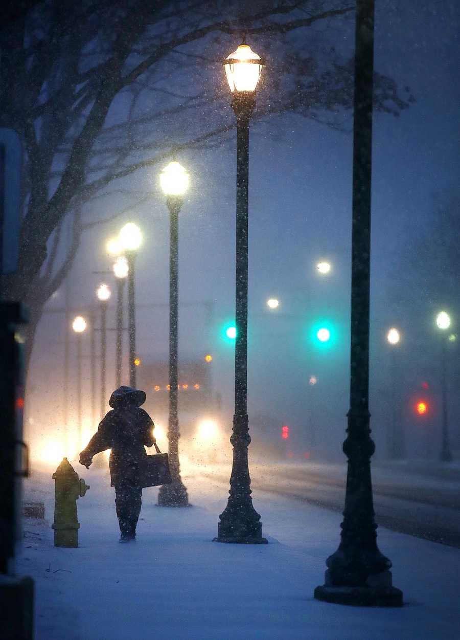 Marie Pierre, of Randolph is bundled as she deals with snowfall on Washington Street in Braintree. Snow began to fall around 4pm across the South Shore as a major winter storm was expected to hit the region, Tuesday, Jan 21, 2014.