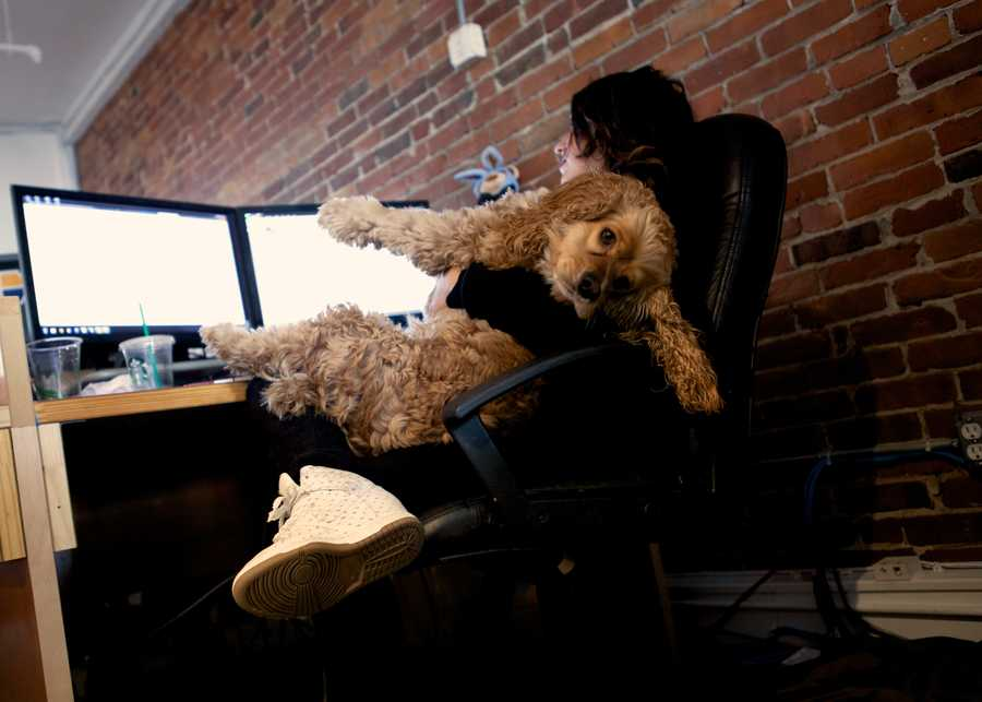 "Molina hugs her dog when she is working at her company, Karmaloop, a web fashion retailer. ""My company allows me to take Charlie to work everyday,"" said Molina,""A lot of companies should be like this. We still need to get our stuff done, but we have a happy environment."""