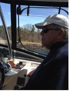 Chet at the helm of his boat.