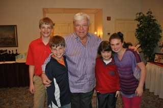 Chet surrounded by his grandchildren.