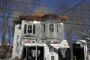 Firefighters battled a three-alarm fire in Waltham on Friday.