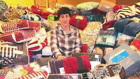 Dracut High junior Alex Corcoran has collected generous donations of 890 blankets for the area's needy in his three years at the school. Before he graduates, he hopes to surpass the 1,000-blanket mark.