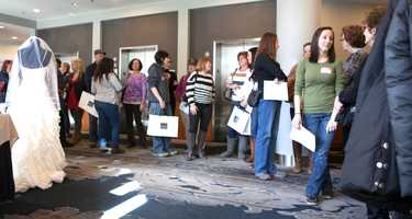 Brides line up at theLe Meridien Cambridge-MIT, waiting for a wedding gown sale organized by Brides Against Breast Cancer. About 1000 gowns are available at discounts from 25 percent to 80 percent with proceeds of the sales going to support cancer patients and their families.