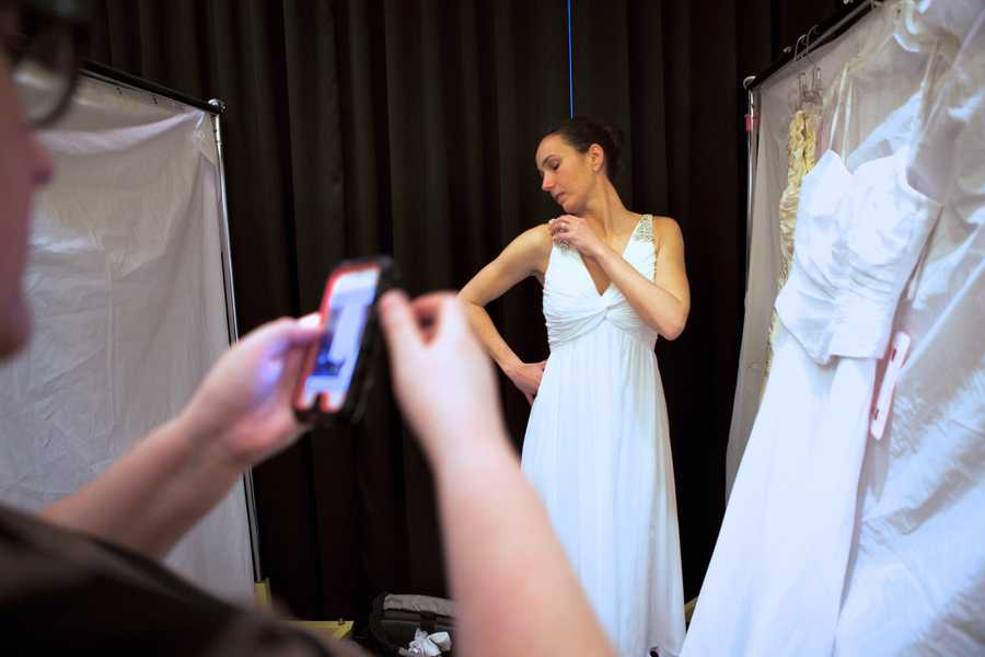Colavito tries on a gown she just picked.
