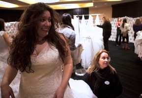 """Jullian Lamy, who is getting married next year, tries on a gown. """"Will it be too short?"""" she asks her parents.She wantsto make sure her partner won't see the gown until their wedding."""