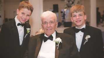 Chet with two of his grandchildren at his daughter Lindsay's wedding.