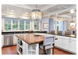 The remodeled kitchen offers brand new cabinets.