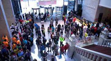 """Participants and other supporters of """"ClimbAmerica"""" cram into the lobby of 53 State St. Sunday morning."""