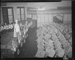 The late Boston Cardinal Cushing leading a prayer service with inmates at the Charlestown State Prison.