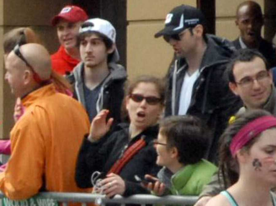 """Dzhokhar Tsarnaev, seen along Boylston Street with his brother Tamerlan, """"committed the offense after substantial planning and premeditation,"""" the government charged."""