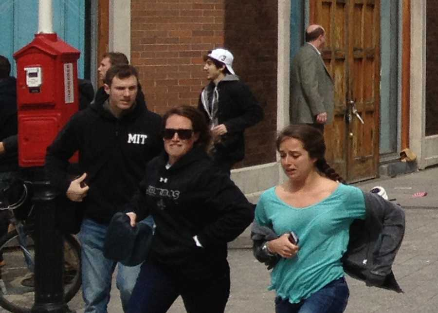 """""""In conjunction with committing acts of violence and terrorism, Dzhokhar Tsarnaev (seen in the background running after the bombings) made statements suggesting that others would be justified in committing additional acts of violence and terrorism against the United States,"""" the filing said."""