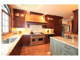 A large eat in island kitchen newly done with top of line appliances.