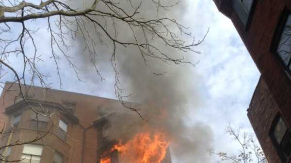 A seven-alarm fire was raging at a six-story apartment building at 31 Mass Ave. in Boston Saturday afternoon.