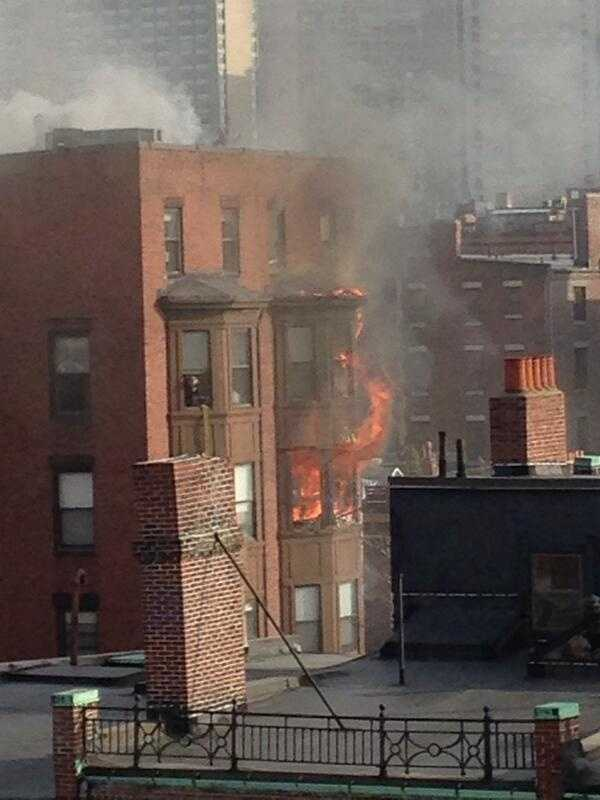 Fire officials said they responded at 2:05 p.m. to a report of building fire and saw heavy fire showing from the rear.