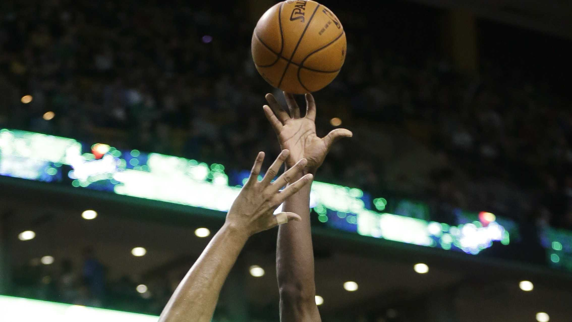 Boston Celtics forward Jeff Green (8) shoots at the basket as Orlando Magic forward Tobias Harris (12) tries to block in the first quarter of an NBA basketball game on Sunday, Feb. 2, 2014, in Boston. The Celtics won 96-89.