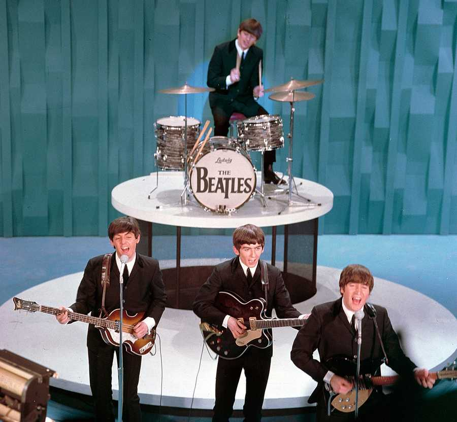 "The Beatles made their U.S. television debut on the ""Ed Sullivan Show"" in New York on Feb. 9. 1964: From left, front, are Paul McCartney, George Harrison and John Lennon. Ringo Starr plays drums."