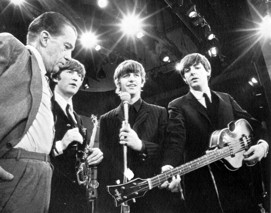 The band takes a break from rehersal with Ed Sullivan on Feb. 8, 1964. From left, Sullivan, John Lennon, Ringo Starr and Paul McCartney. George Harrison missed the rehearsal due to illness.