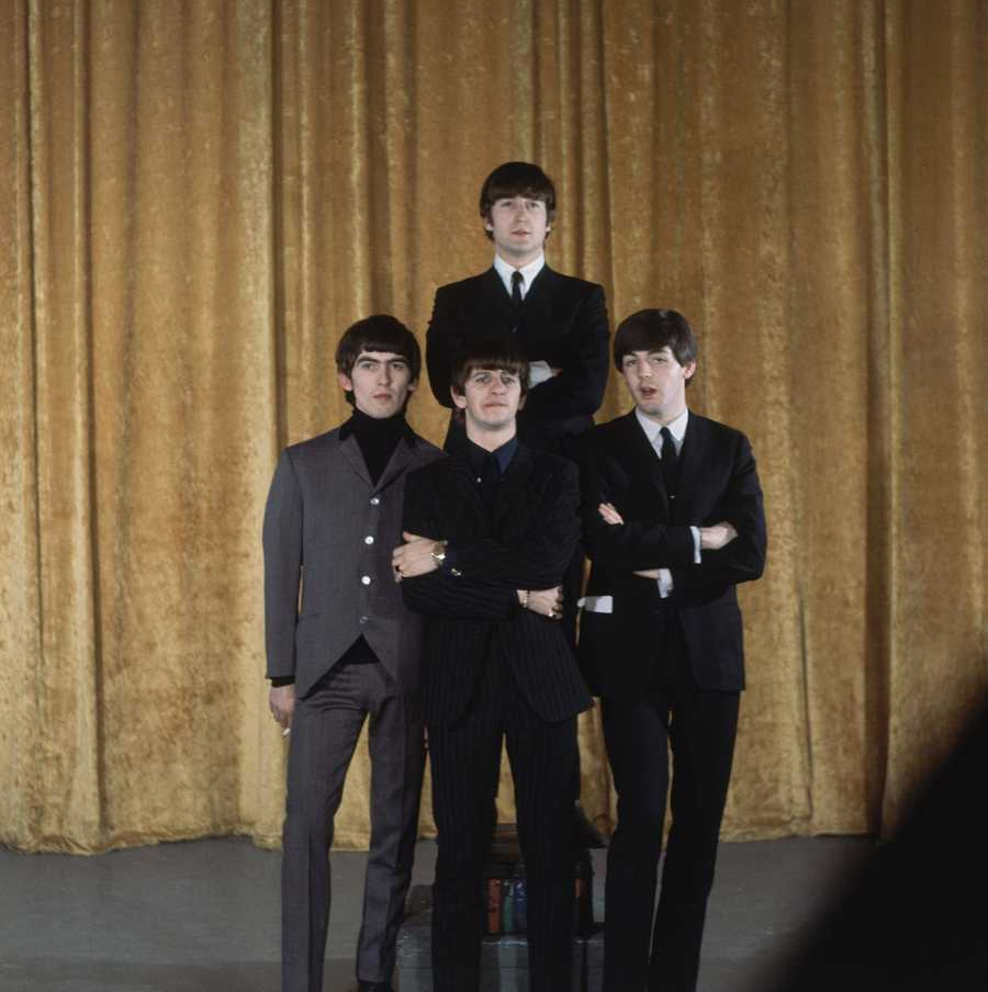 The Beatles pose for pictures on the set.