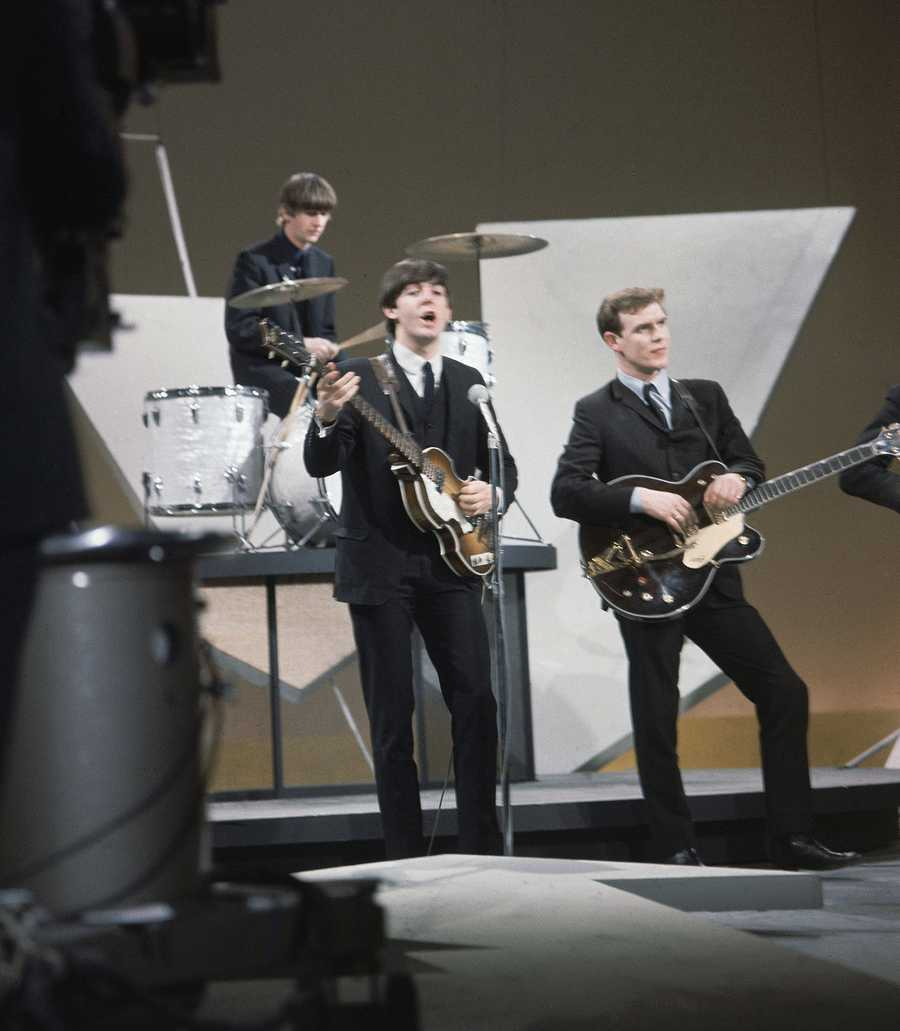 Rehearsing history: On drums is Ringo Starr, bassist and singer is Paul McCartney, and standing in for George Harrison is an unidentified studio worker.
