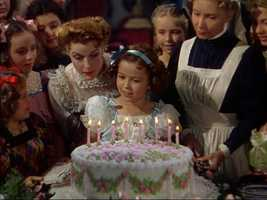 Shirley Temple, the dimpled, curly-haired child star who sang, danced, sobbed and grinned her way into the hearts of Depression-era moviegoers died, publicist Cheryl Kagan. She was 85.