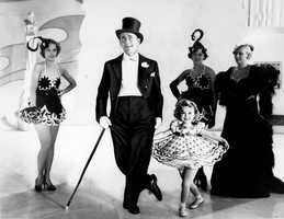 """Six-year-old Shirley Temple is seen in this undated photo as she appeared in her first featured role in the 1934 musical """"Stand Up and Cheer"""" with James Dunn."""
