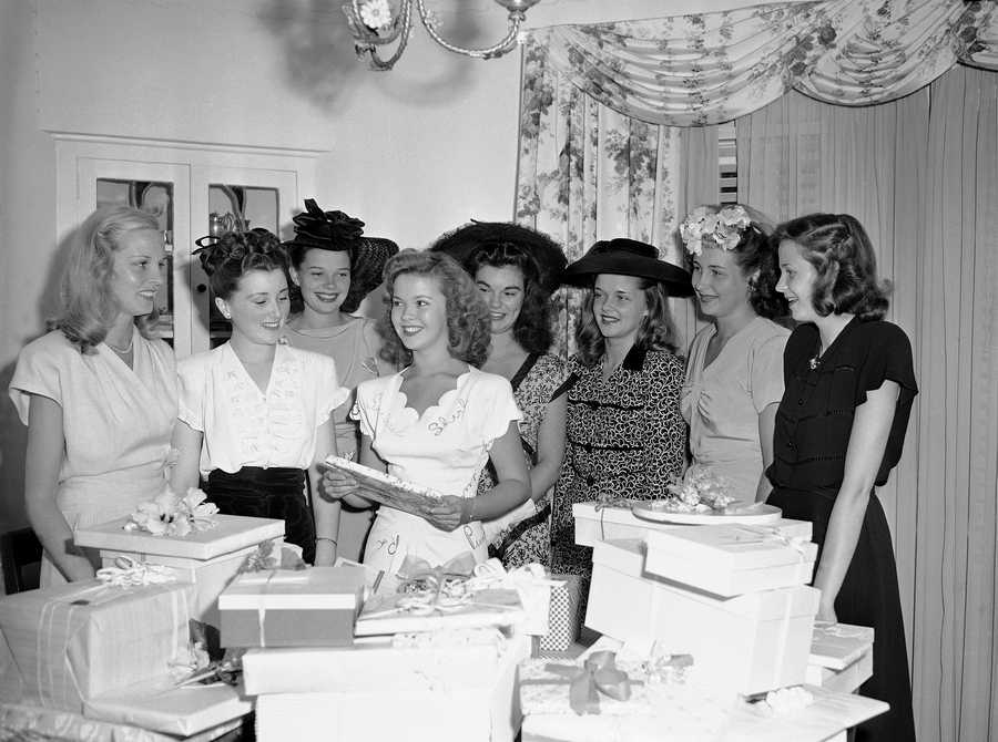 Film actress Shirley Temple, who is engaged to Sgt. John Agar of the Army Air Forces, was given a shower by fellow students of the Westlake School for Girls in Beverly Hills, Calif., Aug. 14, 1945.
