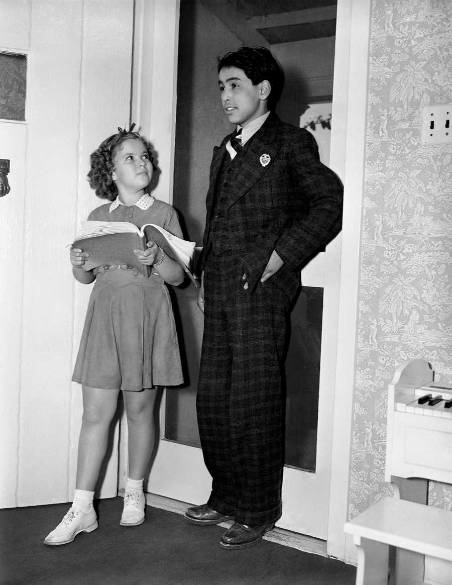 """Shirley Temple gets the first leading man of her screen career in her latest picture, """"Susannah of the Mounties,"""" in 13-year-old Martin Goodrider, a full-blooded Blackfoot Indian boy from the Catholic Mission school on the Blackfoot reservation in Montana, 1938."""