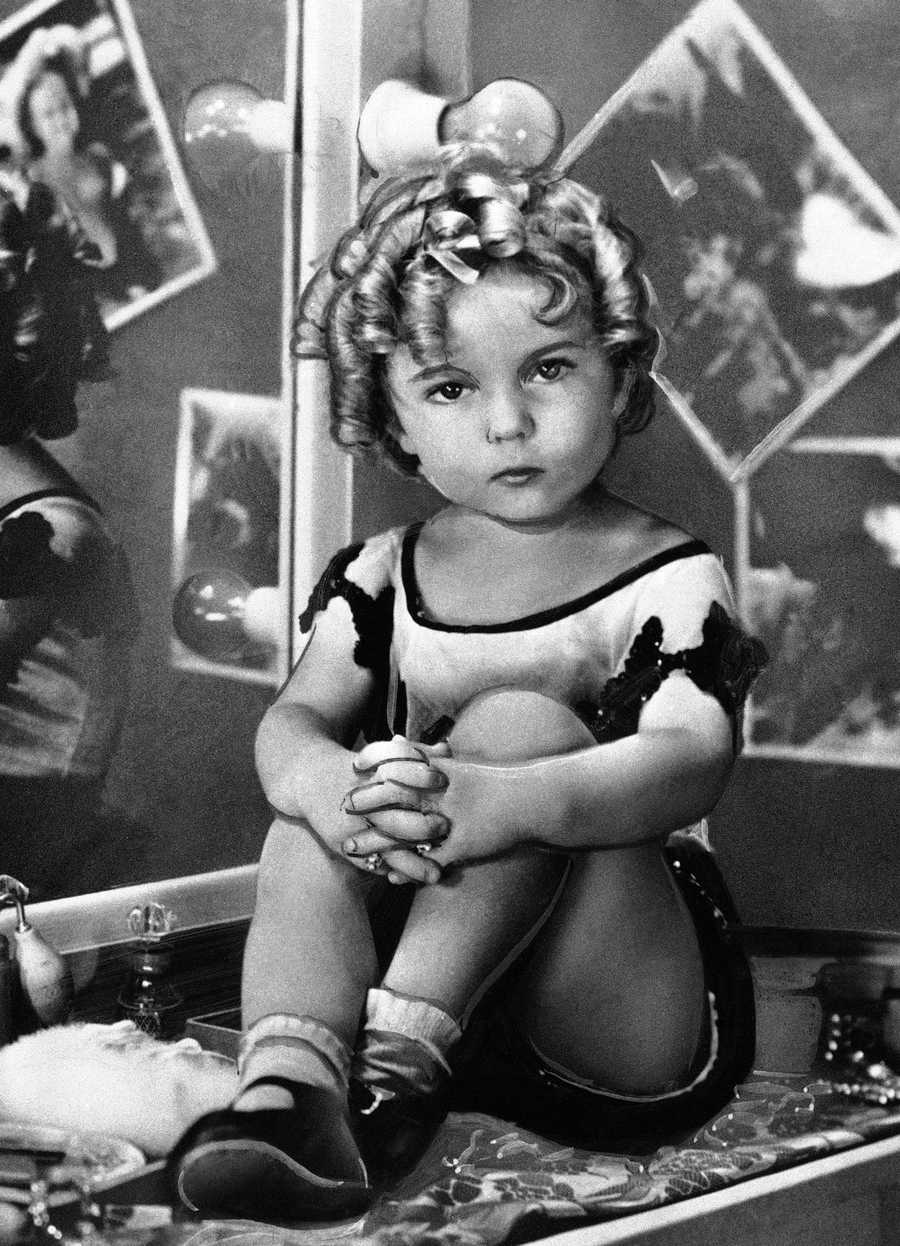 Actress Shirley Temple poses in 1932.