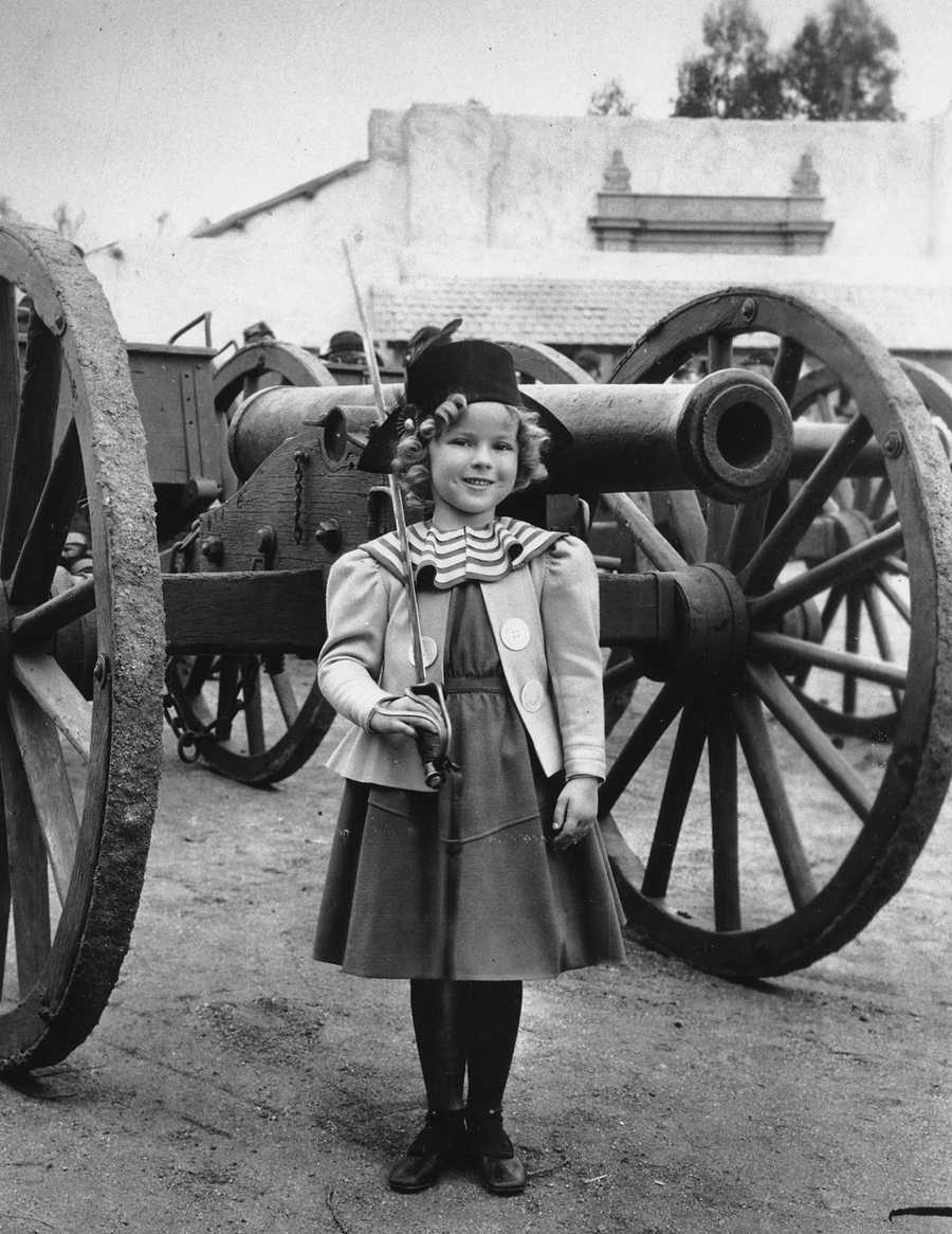 """Shirley Temple is photographed in 1935 as she appeared in """"The Little Colonel,"""" a movie co-starring Lionel Barrymore."""
