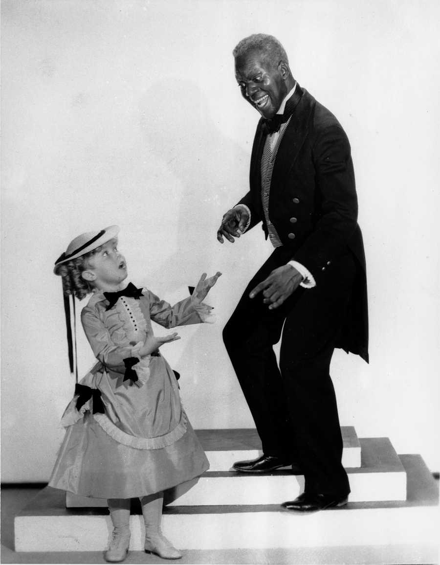 """Shirley Temple and tap dancer Bill """"Bojangles"""" Robinson are shown in a scene from the 1935 motion picture """"The Little Colonel,"""" one of four movies they appeared in together."""
