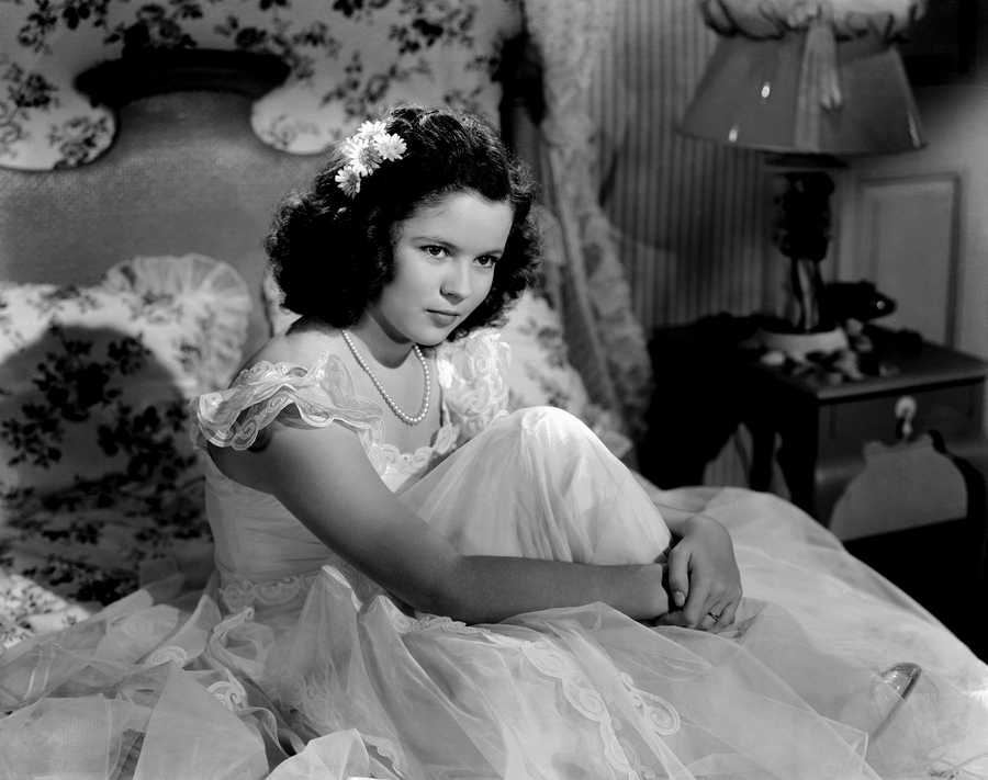 Shirley Temple is shown, Nov. 3, 1941. Her hair has grown darker as she has grown up.