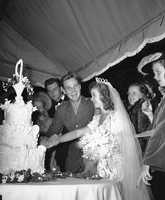 Newlyweds Shirley Temple and Sgt. John Agar Jr. cut their wedding cake beneath a tent on the lawn of the Temple estate on Sept. 19, 1945.