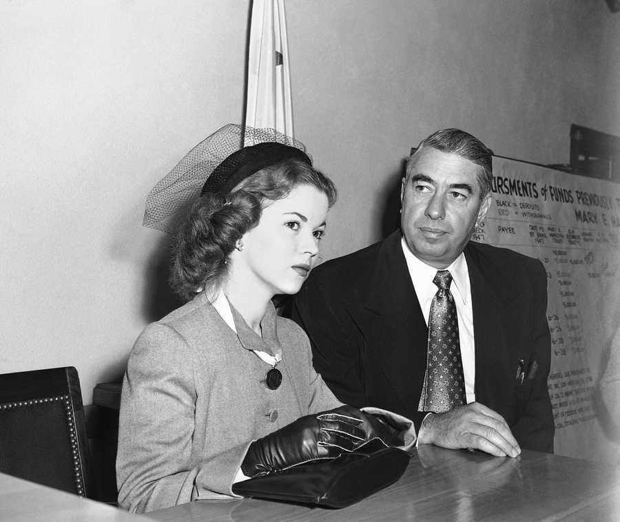 Shirley Temple and her attorney George Stahlman sit at counsel table at divorce proceedings, Dec. 5, 1949. Shirley was granted a divorce from actor John Agar.