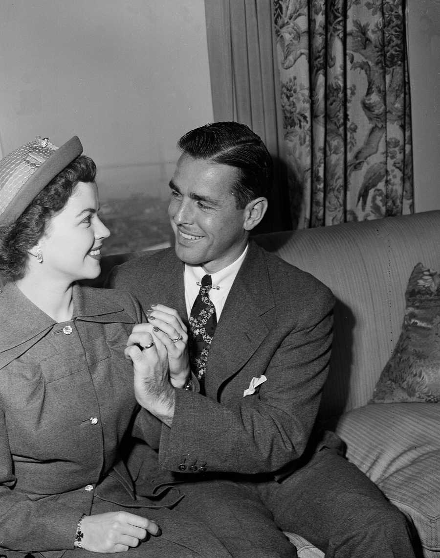 Shirley Temple and her new husband Charles Black, Dec. 20, 1950, hold hands as they permit photos to be taken for the first time since their marriage in Monterey, Calif. Temple also announced that she was retiring from films.