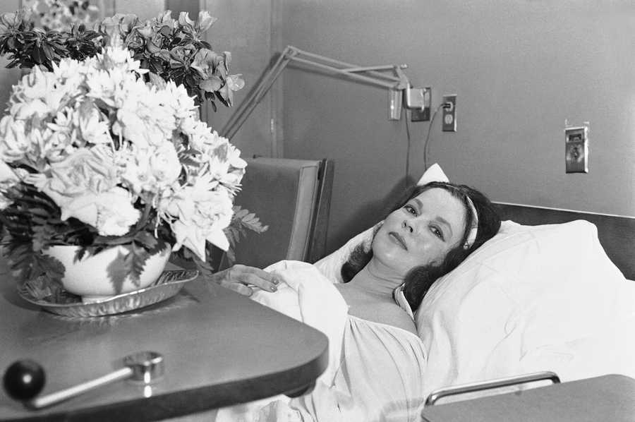 Shirley Temple Black, former film star and political figure, poses for photographers in her room at Stanford University Medical Center in Palo Alto, California on Monday, Nov. 7, 1972. She underwent surgery for removal of a cancerous breast on Friday. Physicians said they had removed all traces of a malignant tumor.