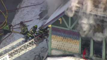 A fire tore through a Cohasset antiques shop early Wednesday afternoon.