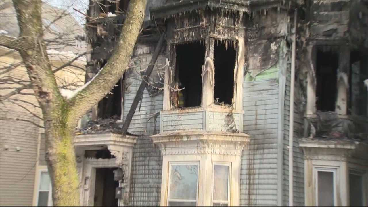 A woman was killed trying to escape a 3-alarm fire inside her Cambridge home on Wednesday morning.