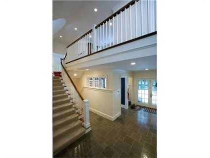 Lower Level with: exercise room with steam shower bath, wine cellar, card room with surround sound and T.V., and play room.
