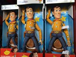 """Buy your souvenirs at the end of the day. Sure, most rides have little pockets to stow your goodies, but who really wants to drag around a """"Toy Story"""" Woody doll all day?"""