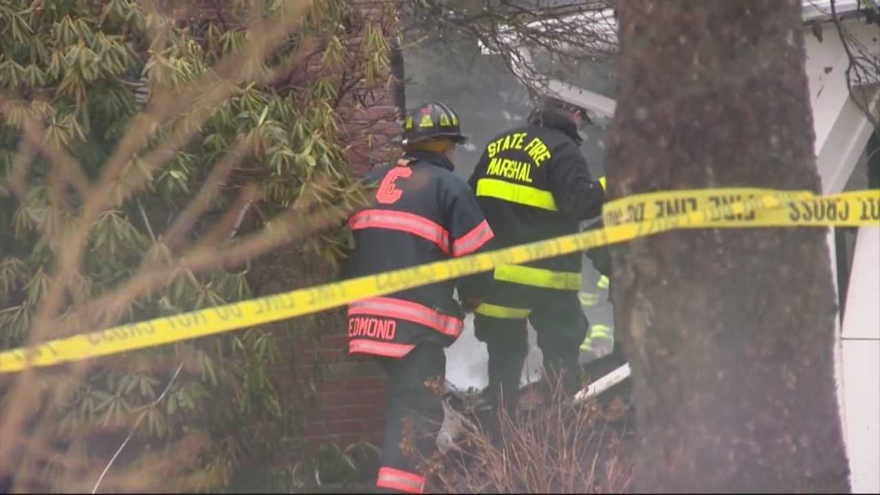 Investigators seek cause in fire that killed elderly couple