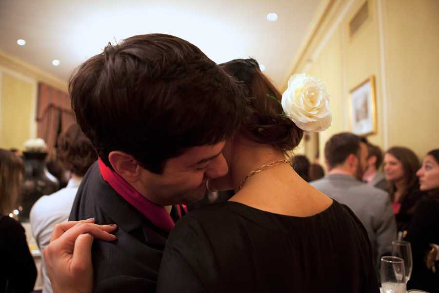 """A couple hugs each other before """"Dine in the Dark,"""" a dining event on Valentine's Day at Hampshire House."""