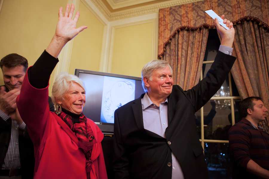"""Pauline Medice (left) 70, and Al Medice (right), 71, raise their hands when the host asks the crowd, """"Which couple has been together for more than 40 years?"""""""