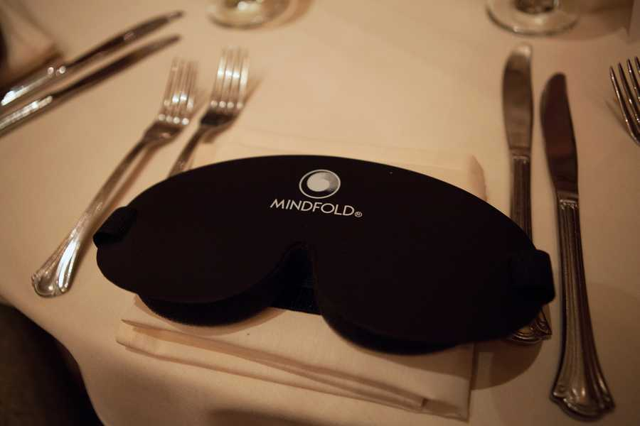 """Instead of dining in dark rooms, guests blindfolded themselves. """"People feel safer,"""" said Markus Ripperger, the corporate executive chef, who brought this idea from his home in Switzerland to Boston. """"If you are in a dark room, even your eyes are open, you don't feel safe. But you are blindfoldedin a bright room here."""""""