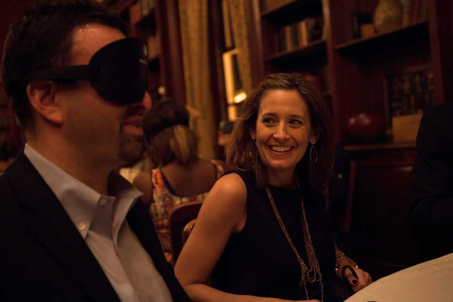 After being seated, John Puopolo (left) puts his mask on while his wife, Michele Palmer (right) is not prepared yet.
