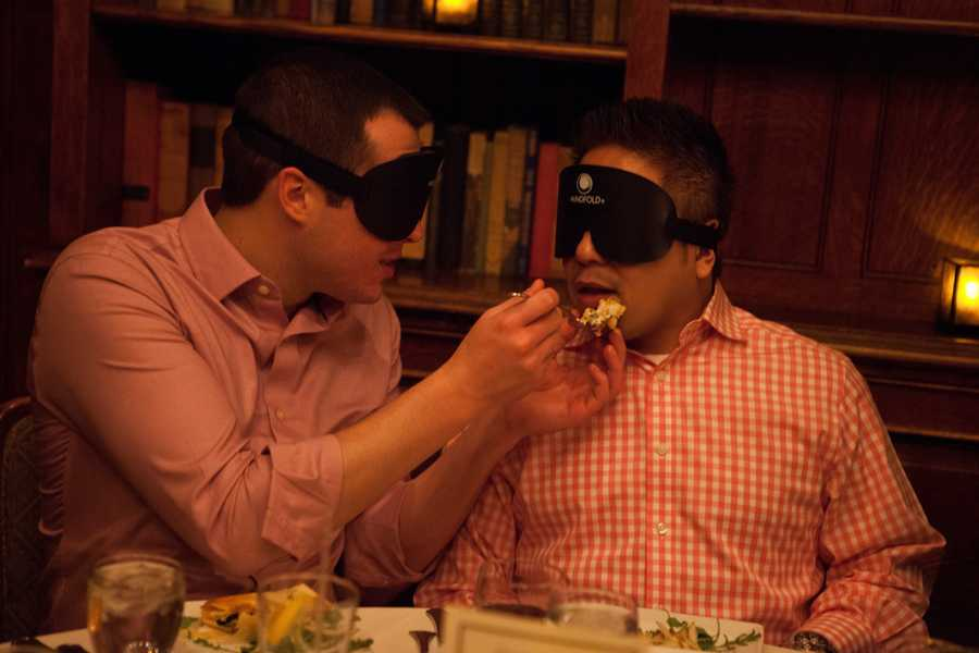 """Olson feeds Soriano during the dinner. """"Where is your mouth?"""" Olson asks."""