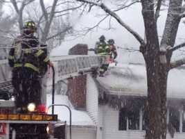 Hingham firefighters battle a fire during the snowstorm