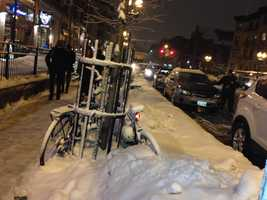 Bikes in snow in Boston