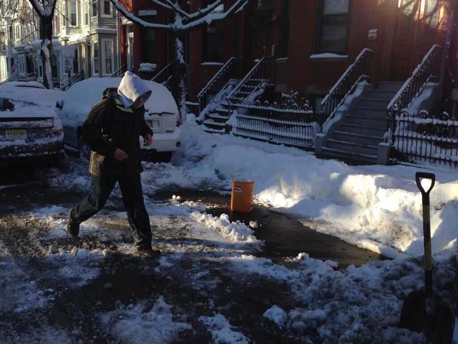 Saving a shoveled-out parking space in South Boston.