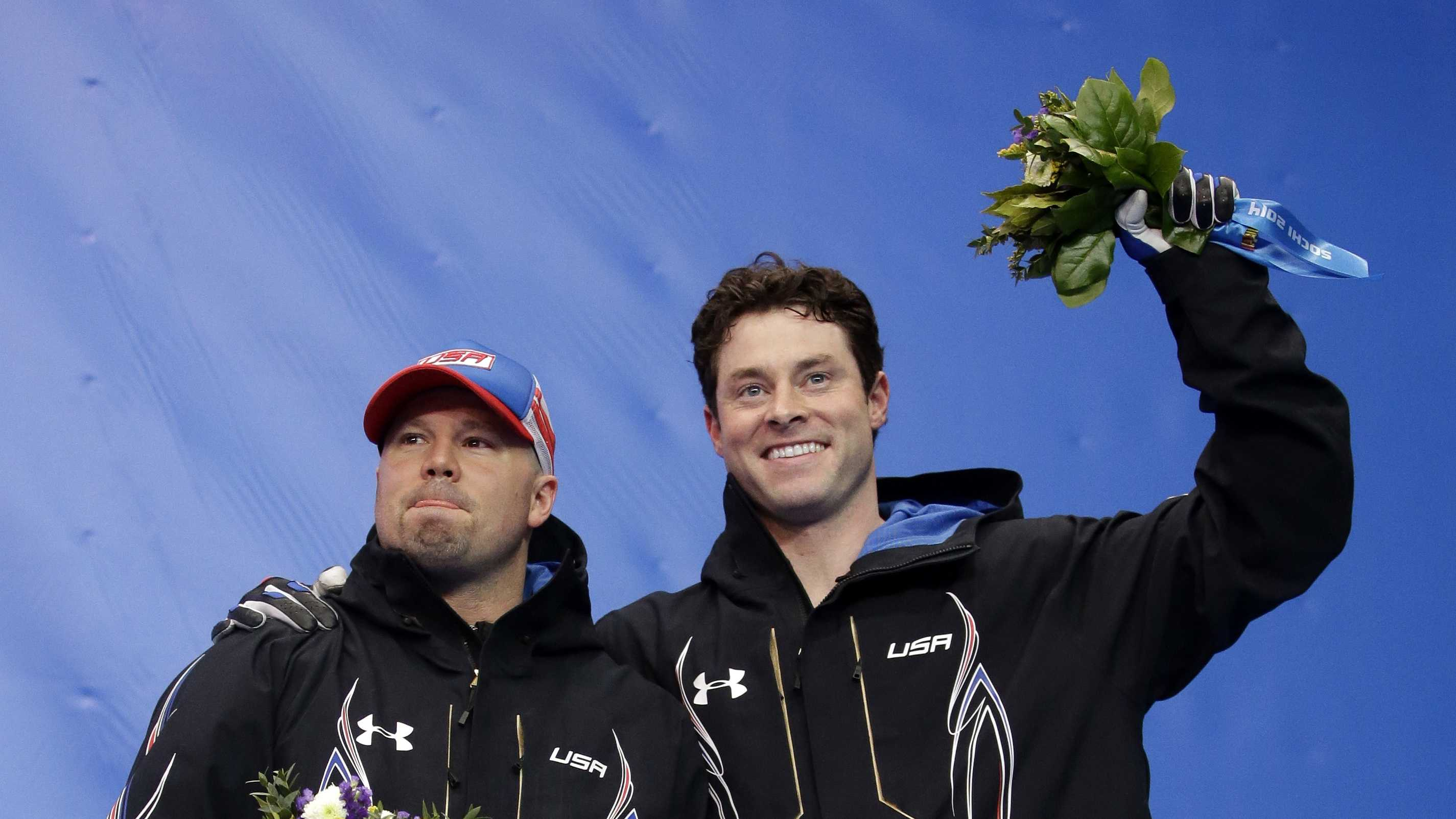 The team from the United States USA-1, piloted by Steven Holcomb (left) and brakeman Steven Langton, celebrate their bronze medal win after the men's two-man bobsled competition at the 2014 Winter Olympics, Monday, Feb. 17, 2014, in Krasnaya Polyana, Russia.